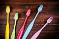 Set of colorful toothbrush on blackboard Stock Photography