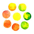 Set of colorful yellow, orange and green hand drawn watercolor spots, circles isolated on white .