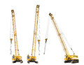 Set of construction yellow crawler cranes isolated on white background Royalty Free Stock Images