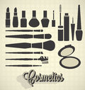 Set of cosmetics silhouettes including brushes polish compact and lipsticks Royalty Free Stock Images