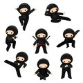 Set of cute ninjas in various poses isolated on white background Royalty Free Stock Photo