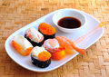 Set of delicious sushi on white plate Stock Images