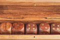Set of dice in a wooden box close-up Royalty Free Stock Photo
