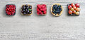Set of different berries on wooden background. Royalty Free Stock Photo