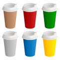 Set of different colored disposable cardboard glasses with plastic covers for coffee or tea Royalty Free Stock Photo