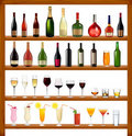 Set of different drinks and bottles on the wall. Stock Image