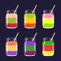 Set of 6 different fresh fruit and berry layered smoothies in mason jars with straw.