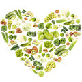 Set of different green fruits and vegetables in the shape of the heart Royalty Free Stock Photo