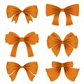 Set of different orange bows for decoration. Decor for Valentine`s Day, birthday, wedding, celebrations and holidays. Royalty Free Stock Photo