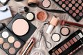 Set of different professional makeup products on furry plaid Royalty Free Stock Photo