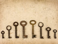 Set of different size antique keys on an old background Royalty Free Stock Image