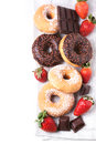 Set of donuts with fresh strawberries Stock Images
