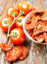 Set of dry and fresh tomatoes on wooden table top view dried old Stock Photo