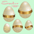 Set of Easter eggs decorated with flowers and gold ribbon. Vecto