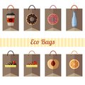 Set of eco paper bags with different products on white background
