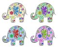 Set of elephants painted by flowers isolated on white cartoon illustration Royalty Free Stock Photos