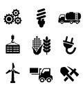 Set of energy and industry icons black depicting machinery electricity mining oil wind turbine plug forklift agriculture Stock Image