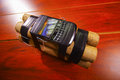 Set of explosives conected to a cellphone laying on the ground Royalty Free Stock Photo