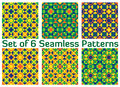Set of 6 fashionable geometric seamless patterns with triangles and squares of green, blue, orange and yellow shades Royalty Free Stock Photo