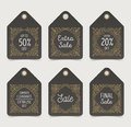 Set of flourishes sale tags or labels. Royalty Free Stock Photo