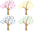 Set of four abstract trees different colored representing the seasons or different colors blooms Royalty Free Stock Images