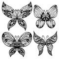 Set of four black butterfly silhouettes hand drawn over white background Stock Photos