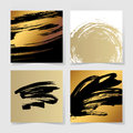 Set of four black and gold ink brushes grunge square pattern Royalty Free Stock Photo