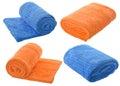 Set (four) of  blue and orange towels isolated on white backgrou Royalty Free Stock Photo