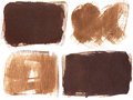 Set of four brown grunge brushstroke backgrounds sepia stain abstract painting Stock Image