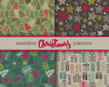 Set of four Christmas vector seamless patterns Royalty Free Stock Photo