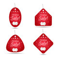 Set of four festive Christmas coupon tags, red with white balls. Suitable for web design and print. Royalty Free Stock Photo