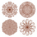 Set of four hand drawn mehandi ornaments ethnic circular Stock Images