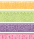 Set of four horizontal textile fabric textures vector seamless patterns borders with hand drawn elements Royalty Free Stock Images