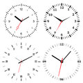 A set of four mechanical clocks. Clock face