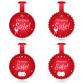 Set of four round festive Christmas coupon tags, red with white balls. Suitable for web design and print. Royalty Free Stock Photo