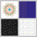 A set of four seamless patterns. The pattern of spirals. Multicolored small spiral on a dark and a light background. Royalty Free Stock Photo