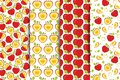 Set of four Seamless patterns with red whole and half sliced apples on a white background. Fruit Background for print. Royalty Free Stock Photo