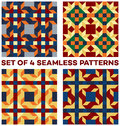 Set of four stylish geometric seamless patterns with rhombus, triangles and squares of blue, green, golden, orange, beige and red Royalty Free Stock Photo