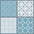 Set of four vintage symmetric seamless patterns vector Royalty Free Stock Photo