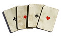 Set of four vintages aces from a deck playing cards with dirty grimy surfaces and a simple design showing just the suite in the Royalty Free Stock Photos