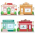Set of front facade buildings: bakery, barbershop, pizzeria and pharmacy with a sign and symbol in shopwindow