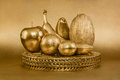Set of fruits with golden peel on gold background Royalty Free Stock Photo