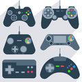 Set gamepad icons of various gamepads joysticks of different generations with bright buttons into flat style vector illustration Royalty Free Stock Image
