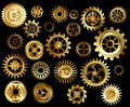 Set of gears gold and brass on a black background Royalty Free Stock Photos