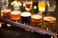 Set of glasses of light and dark beer on a pub background. Royalty Free Stock Photo