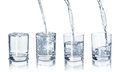 A set of glasses with water on an Royalty Free Stock Photo
