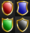 Set of gold framed shields with colors red blue green black Stock Images