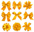 Set of gold gift bows with ribbons. Stock Images
