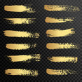 Set of gold paint, ink brush strokes, brushes, lines. Royalty Free Stock Photo