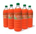 Set of grapefruit drinks in plastic bottles Royalty Free Stock Images